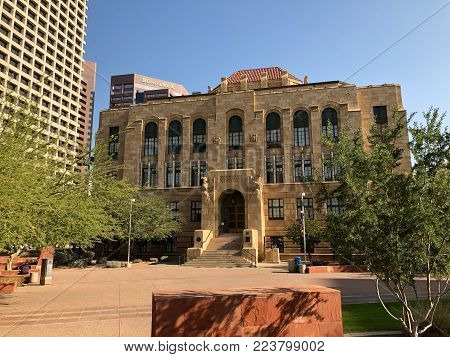 PHOENIX, AZ, USA - DECEMBER 14, 2017: Historic Phoenix City Hall contrasted with a modern utilitarian architecture