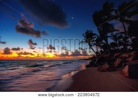 Punta Cana tropical beach at sunrise , Dominican Republic.