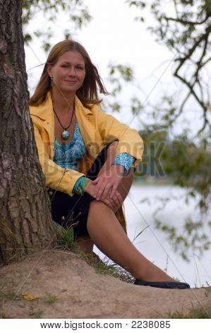 Woman Sitting Near The Tree