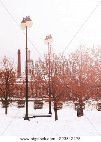 street light against the winter sity, metal object