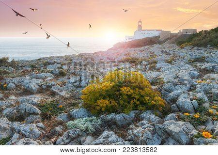Lighthouse at colorful sunset, St. Vincente Lighthouse, Sagres, Portugal