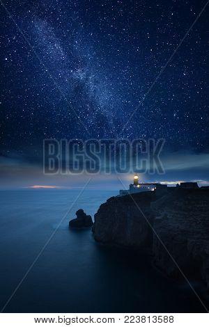 Lighthouse under starry night. Cape St. Vincent Lighthouse, Sagres, Algarve, Portugal.