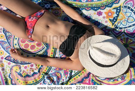 Summer leisure, Woman Sunbathing On Beach. Recharge the batteries on summer vacation.
