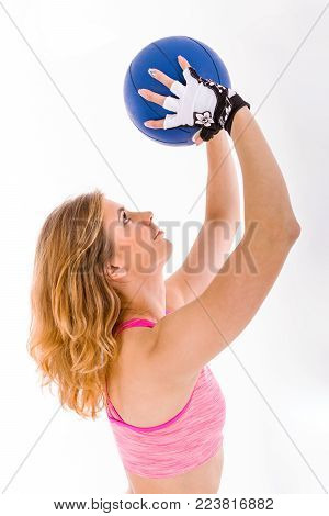 Beautiful Young Woman Training with Medball. Sport Concept.