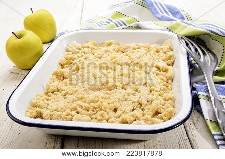 british apple crumble in a blue and white enamel bowl
