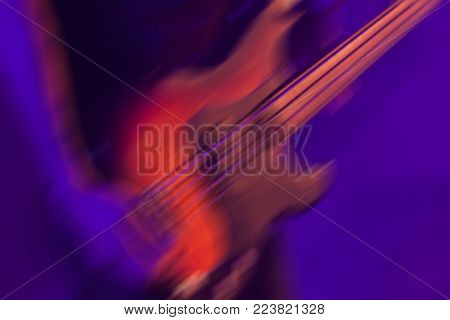 Bass Guitar Player Blurred Photo Background