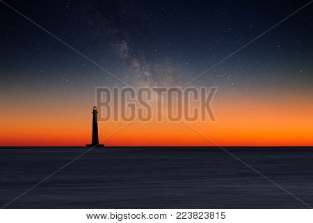 Lighthouse against night sky. Morris Island Lighthouse, South Carolina, USA