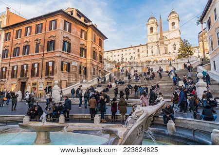 Italy, Rome, January 2018 - Crowd of people at Piazza di Spagna and the Spanish Steps