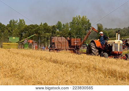 ROLLAG, MINNESOTA, Sept 2, 2017: International and John Deere combines demonstrations harvesting at the annual WCSTR farm show in Rollag held each Labor Day weekend where 1000's attend.