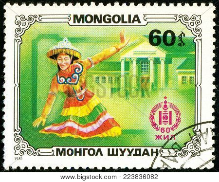 Ukraine - circa 2018: A postage stamp printed in Mongolia show Folksinger, folk dancer. A woman in a Mongolian national costume. Series: Sport and culture. Circa 1981