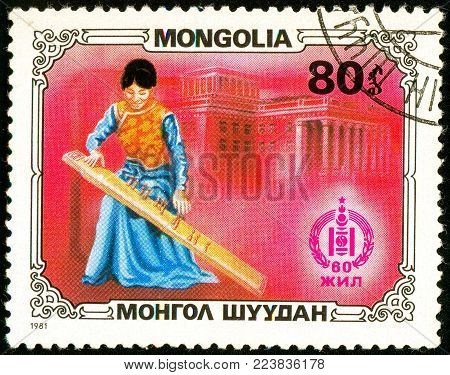Ukraine - circa 2018: A postage stamp printed in Mongolia show Girl in a Mongolian national costume playing jatga. Series: Sport and culture. Circa 1981