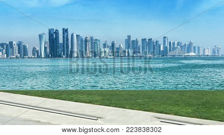 Panoramic view on financial center of Doha from West Bay. Doha is a city on the coast of the Persian Gulf, the capital and largest city of the Arab state of Qatar, Panoramic landscape