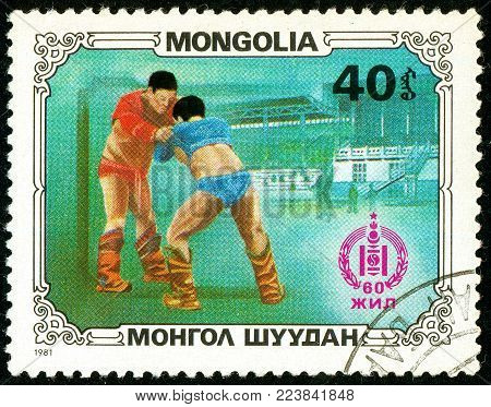 Ukraine - circa 2018: A postage stamp printed in Mongolia show Wrestlers. Wrestling is the national sport of Mongolia. Series: Sport and culture. Circa 1981