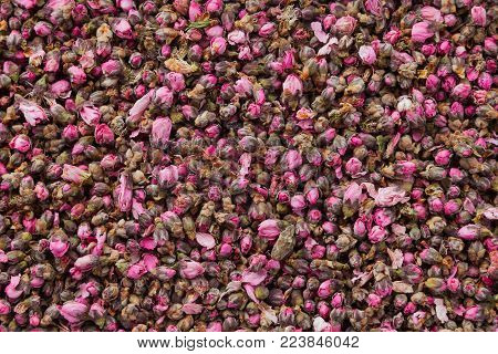 Tea flowers texture. Peach blossom tea with lemon. Organic dried flower tea leaves