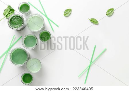 Detox green smoothies background, view from above, space for a text