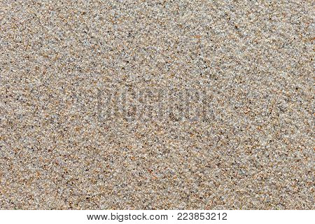 smooth the surface of wet quartz sand. The background image, texture. top view