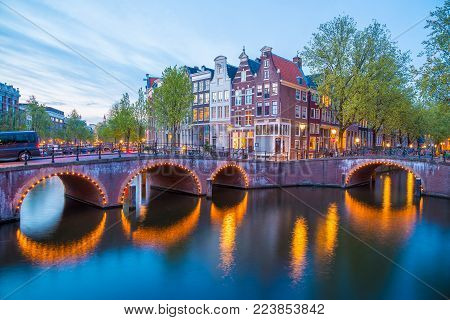 Bridge over Keizersgracht - Emperor's canal in Amsterdam, The Netherlands at twilight. HDR image.