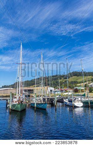 Huonville, Tasmania, Australia - 24 December 2015: scenic landscape of boats on the Huon river