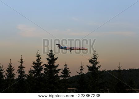 St. Petersburg, Russia - 21 June, The plane is landing at sunset, 21 June, 2016. Takeoff and landing of aircraft at the airport in St. Petersburg, Pulkovo.