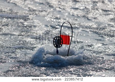 Winter fishing tackle for catching predatory fish on the ice of the river