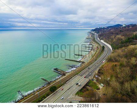 Drone view of Kurortnyy Prospekt and Black Sea in cloudy autumn day, Sochi, Russia