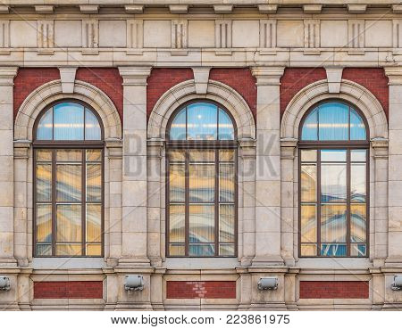 Three windows in a row on the facade of the urban historic building front view, Saint Petersburg, Russia