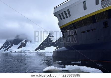 cruise ship navigating on icy waters in winder