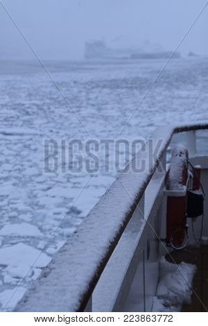 cruise ship navigating on icy waters in winter