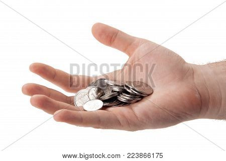Russian ruble coins in the palm of a person isolated