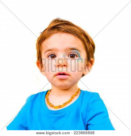 innocent baby face isolated painted blue face expression newborn .