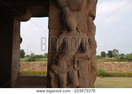 Statues the decorating columns of the ancient temple in the city of Aykhole in India Statues the decorating columns of the ancient temple in the city of Aykhole in India