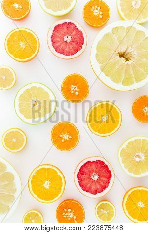 Fruits pattern of lemon, orange, grapefruit, sweetie and pomelo on white background. Flat lay, top view. Fruit's background