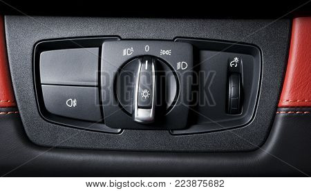 Car interior with light switch.the light knob in the car. Multifunction Headlight Console Control Switch Knob
