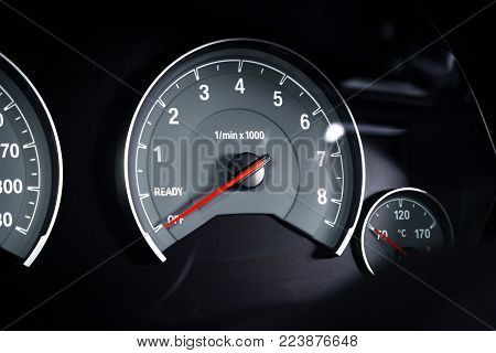 Close up shot of a tachometer, rounds of the engine per minute, in a car.