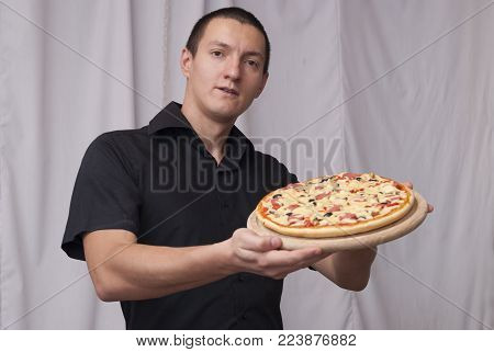 Man Holding A Pizza