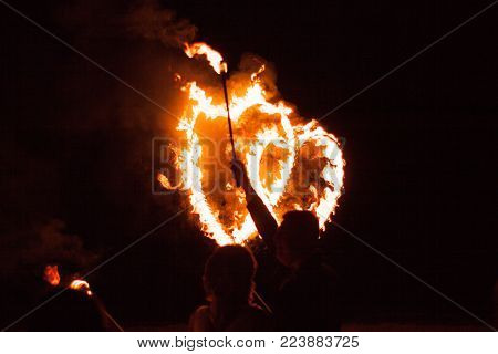 Fire heart at night on black background on wedding