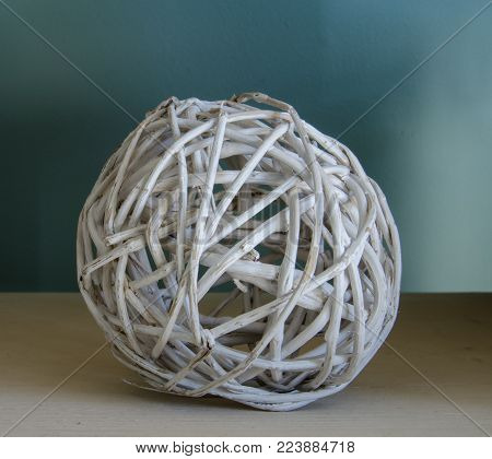 Woven white wicker ball is a simple home decoration