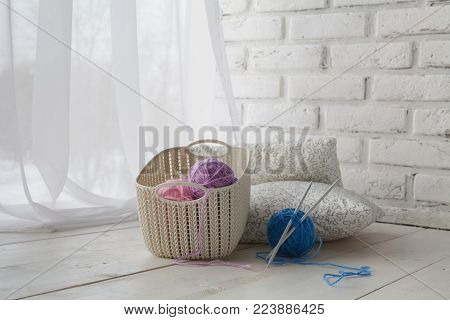 Home Organizers Colored Baskets With Handmade Accessories On Whote Table