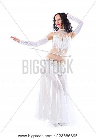 Arabian bellydancer sexy woman in white costume on white background. Sensual arabic girl belly dancer dancing in studio. Oriental beauty model in studio portrait.