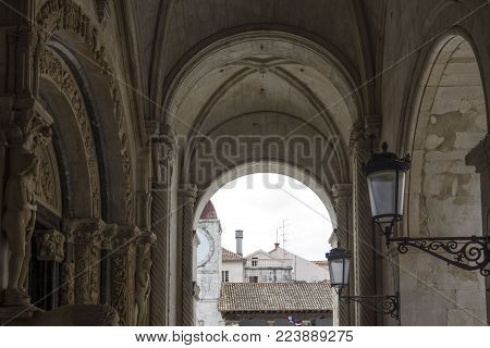 Trogir, Croatia - August 12 2017: Colonnade Of St.lawrence Cathedral, Looking At The Clock-tower