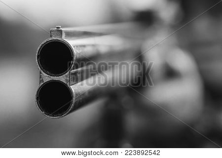 Close up of double barrel hunting gun. Black and white