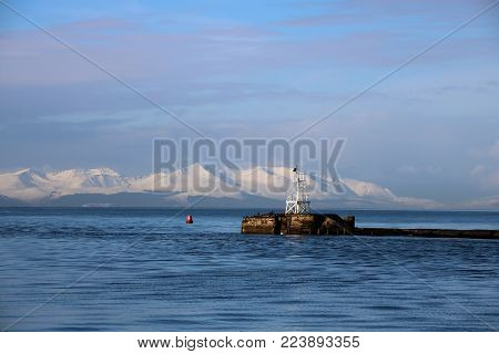 Isle of Arran in winter from Ayr harbour Scotland