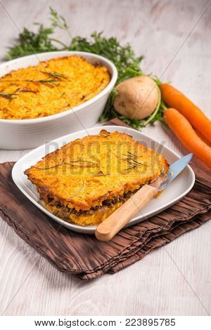 cake with potatoes carrots and minced meat, selective focus