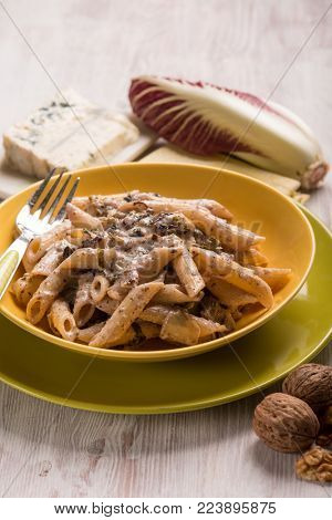 pasta with red chicory gongorzola and walnuts, selective focus