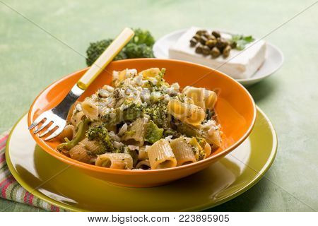 pasta with broccoli feta cheese and capers, selective focus