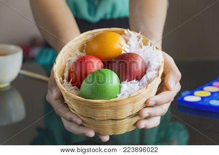 Close up of colorful Easter eggs in a basket.Easter concept.
