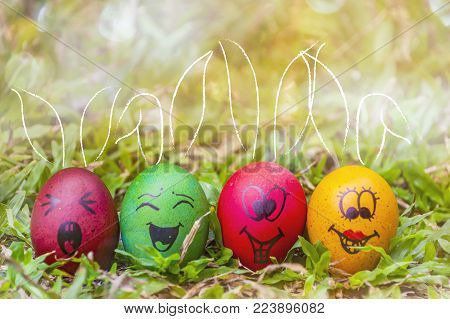 Row of Easter eggs in Fresh Green Grass,Blured background.