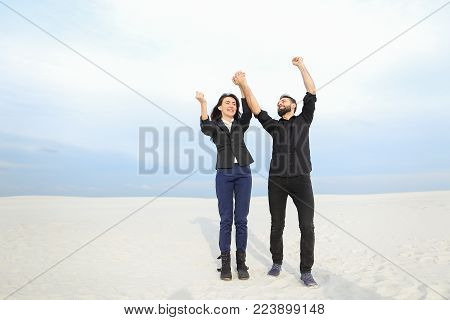 happy physicists fellow and girl having rest after defending thesis, young man and woman rejoicing at success. Smiling guy and fair-haired lady in strict suits have good mood. Concept of fashionable clothes, stylish business outfits or accessories.