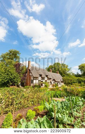 STRATFORD UPON AVON, ENGLAND - AUGUST 9, 2012: Anne Hathaway's (William Shakespeare's wife) famous thatched cottage and garden at Shottery, just outside Stratford upon Avon, England.