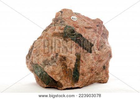 green beryl crystal mineral sample embedded in granite